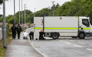 Police officers and members of the bomb squad pictured during a security alert at Southway, Derry. Southway is an arterial route into the Creggan Estate in the city. The area was still sealed off at 4.30pm.