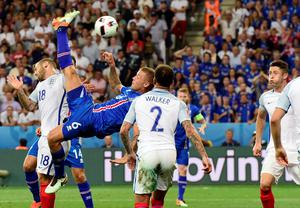 Iceland's defender Ragnar Sigurdsson kicks the ball during Euro 2016 round of 16 football match between England and Iceland at the Allianz Riviera stadium in Nice on June 27, 2016.   / AFP PHOTO / TOBIAS SCHWARZTOBIAS SCHWARZ/AFP/Getty Images