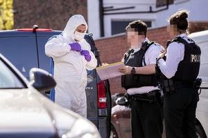 Police and forensic officers at the scene of deathr in the Haywood Avenue area of south Belfast on April 22nd 2020 (Photo by Kevin Scott for Belfast Telegraph)