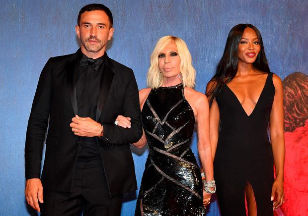 From left, Riccardo Tisci, Donatella Versace and Naomi Campbell arrive for the premiere of 'Franca: Chaos and Creation' at the Venice Film Festival in Venice, Italy, Friday, Sept. 2, 2016.  (Ettore Ferrari/ANSA via AP)