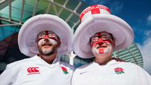 England fans in full team colours and painted faces wait in the sunshine for the first match of the Rugby World Cup 2015, with England facing Fiji at Twickenham Stadium in London on September 18, 2015. AFP PHOTO / LEON NEALLEON NEAL/AFP/Getty Images