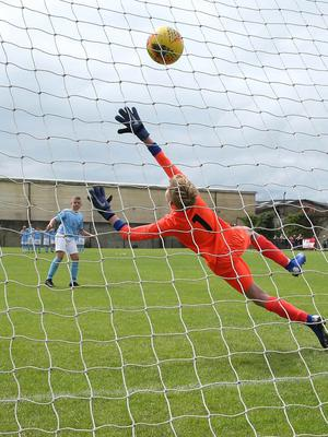 PressEye-Northern Ireland- 1st August 2019-Picture by Brian Little/PressEye Ballymena United Ross Green scores a penalty past Dungannon United Youth goal keeper Harry Rainey during a penalty shoot-out  in  STATSports SuperCupNI  Semi Final , at Anderson Park, Coleraine . Picture by Brian Little/PressEye
