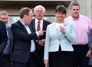DUP deputy leader Nigel Dodds (L) points to DUP leader and Northern Ireland former First Minister Arlene Foster (R) as they hold a photocall with their newly elected candidates who stood in the general election on June 9, 2017 in Belfast, Northern Ireland. (Photo by Charles McQuillan/Getty Images)