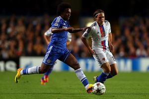 LONDON, ENGLAND - SEPTEMBER 18:  Willian of Chelsea and Kay Voser of FC Basel battle for the ball during the UEFA Champions League Group E Match between Chelsea and FC Basel at Stamford Bridge on September 18, 2013 in London, England.  (Photo by Clive Rose/Getty Images)