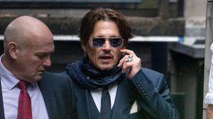 A judge ruled Johnny Depp is in breach of a court order for failing to disclose texts, which apparently show him trying to obtain drugs, to The Sun's lawyers ahead of his libel trial against the newspaper (Aaron Chown/PA)