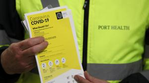 Leaflets which form part of the public awareness campaign for Covid-19 at Dublin Airport (Brian Lawless/PA)