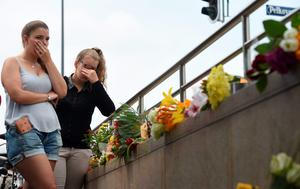 Two young women mourn at an underground station near the Olympia-Einkaufszentrum shopping centre on July 23, 2016, one day after the attack at the shopping centre in Munich, southern Germany. AFP/Getty Images