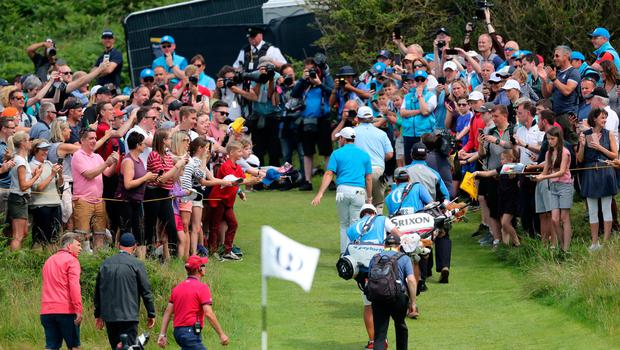 Northern Ireland's Rory McIlroy walks through the walkway during preview day three of The Open Championship 2019 at Royal Portrush Golf Club. PRESS ASSOCIATION Photo. Picture date: Tuesday July 16, 2019. See PA story GOLF Open. Photo credit should read: Niall Carson/PA Wire. RESTRICTIONS: Editorial use only. No commercial use. Still image use only. The Open Championship logo and clear link to The Open website (TheOpen.com) to be included on website publishing.