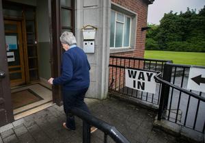 A voter arrives at the polling station in St Nicolas Parish Hall, Belfast, as voting gets underway in the 2017 General Election.  Liam McBurney/PA Wire