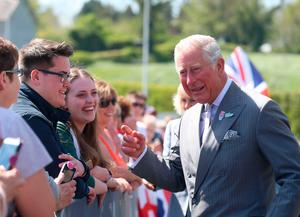 The Prince of Wales meets well wishers ahead of a tour of the new centre in Bellaghy, dedicated to poet Seamus Heaney during their visit to Northern Ireland.  Liam McBurney/PA Wire