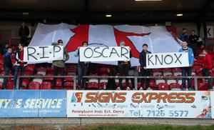 Derry City fans pay tribute to Oscar Knox during the team's match against Shamrock Rovers, Friday May 9, 2014