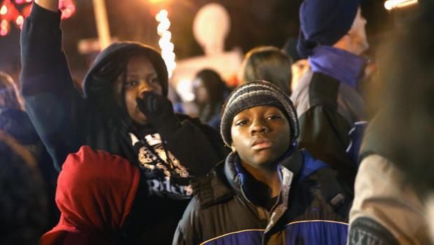 FERGUSON, MO - NOVEMBER 24:  Demonstrators wait outside the Ferguson police department for the grand jury's announcement in the Michael Brown case on November 24, 2014 in Ferguson, Missouri. Ferguson has been struggling to return to normal after Brown, an 18-year-old black man, was killed by Darren Wilson, a white Ferguson police officer, on August 9. His death has sparked months of sometimes violent protests in Ferguson. A grand jury today declined to indict officer Wilson.  (Photo by Scott Olson/Getty Images)