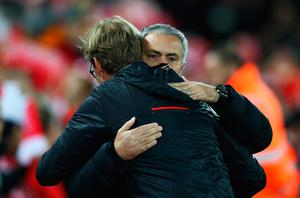 LIVERPOOL, ENGLAND - OCTOBER 17: Jose Mourinho, Manager of Manchester United is greeted by Jurgen Klopp, Manager of Liverpool during the Premier League match between Liverpool and Manchester United at Anfield on October 17, 2016 in Liverpool, England.  (Photo by Clive Brunskill/Getty Images)