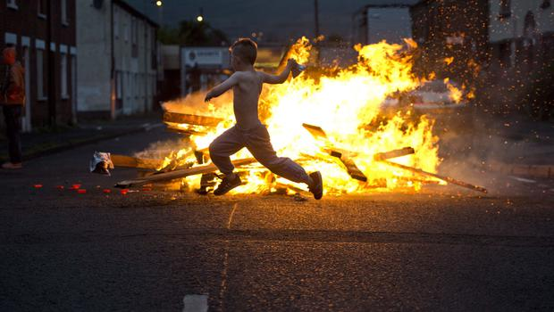 Loyalist area's across Northern Ireland get ready to kick off the 12th of July celebrations with the traditional bonfires. Mark Marlow/Pacemaker Press.