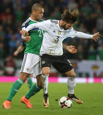 October 5th 2017 - FIFA World Cup - Qualifying Group C Northern Ireland V Germany - National Football Stadium at Windsor Park Northern Ireland's Josh Magennis and Germany's Marvin Plattenhardt.