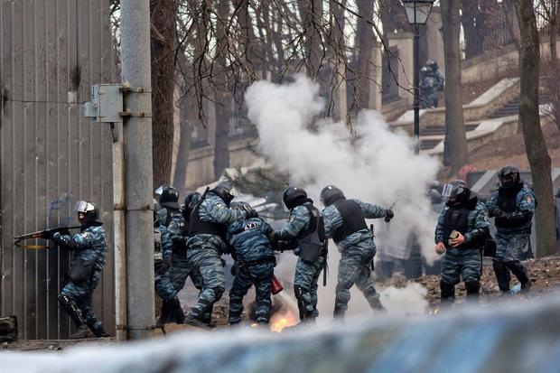 Riot police officers clash with anti-government protesters during unrest in central Kiev, Ukraine, Monday, Jan. 20, 2014. After a night of vicious streets battles, anti-government protesters and police clashed anew Monday. (AP Photo/Evgeny Feldman)