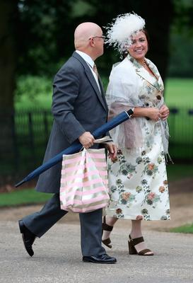 The first guests (identities unknown) arrive ahead of the wedding of the Duchess of Cambridge's sister Pippa Middleton to her millionaire groom James Matthews, dubbed the society wedding of the year at, St Mark's church in Englefield, Berkshire. PRESS ASSOCIATION Photo. Picture date: Saturday May 20, 2017. See PA story ROYAL Pippa. Photo credit should read: Andrew Matthews/PA Wire
