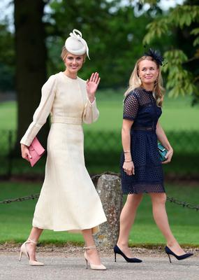 Donna Air waves to the waiting crowds as she arrives ahead of the wedding of the Duchess of Cambridge's sister Pippa Middleton to her millionaire groom James Matthews, dubbed the society wedding of the year at, St Mark's church in Englefield, Berkshire. PRESS ASSOCIATION Photo. Picture date: Saturday May 20, 2017. See PA story ROYAL Pippa. Photo credit should read: Andrew Matthews/PA Wire