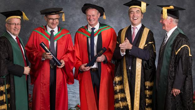 Pictured with Paddy Nixon (Vice-Chancellor), James Nesbitt (Chancellor) and John Hunter (Chair of Council) are football managers Martin O'Neill and Michael O'Neill who both received honorary degrees from Ulster University this morning. Both received the honorary degree of Doctor of Science (DSc) for their contribution to Irish football. (Photo: Nigel Mcdowell/Ulster University)