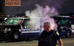 A police vehicle is seen on fire during an anti-Trump protest in Oakland, California on November 9, 2016.  Thousands of protesters rallied across the United States expressing shock and anger over Donald Trump's election, vowing to oppose divisive views they say helped the Republican billionaire win the presidency. / AFP PHOTO / Josh EdelsonJOSH EDELSON/AFP/Getty Images