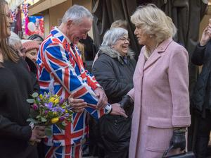 Wearing the flag, Camilla is greeted by a a man in a Union Jack suit (Arthur Edwards/The Sun/PA)