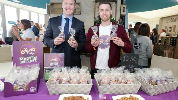 Press Eye - Belfast - Northern Ireland - 18th May 2018  Third day of the 2018 Balmoral Show, in partnership with Ulster Bank, at Balmoral Park.  Jack Morton from  Jack's Fudge pictured with Mark Crimmins Regional Director Business Banking at Ulster Bank.    Jack's Fudge was one of the companies provided with free space by Ulster Bank to exhibit in its marquee. The companies include Ulster Bank customers and entrepreneurs from the bank's Entrepreneur Accelerator.  Picture by Jonathan Porter/PressEye
