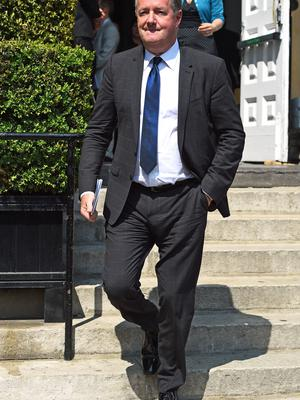 Piers Morgan leaves the church after the funeral service (Kirsty O'Connor/PA)