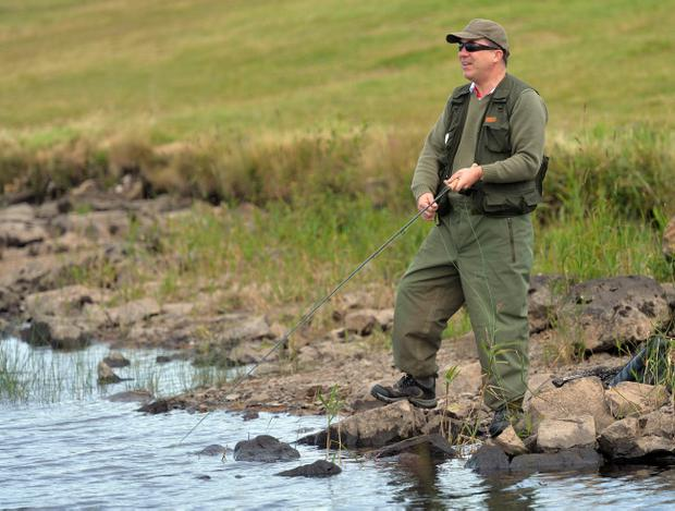 PACEMAKER, BELFAST, 5/8/2013: You're nicked! PSNI Chief Constable Matt Baggott competing in the World Police and Fire Games Pairs Fly Fishing competition at Killylane reservoir near Ballymena today. PICTURE BY STEPHEN DAVISON