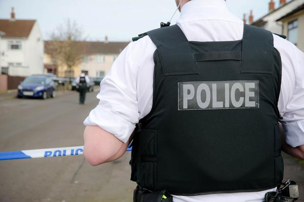Police raided two Belfast houses. [Stock image]