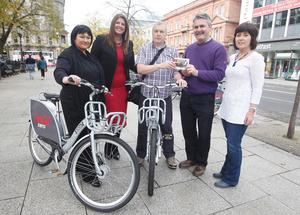 Colin Thompson(centre) with Councillor Declan Boyle, Chair of Belfast City Council's Strategic Policy and Resources Committee; Gillian Shields, Community Investment Manager with Coca-Cola HBC Northern Ireland; Veronica Noble, Client Account Manager with NSL; and Anne Burke from the Department for Regional Development Cycling Unit. (Jonathan Porter/PressEye)