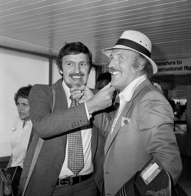 Jimmy Hill, former managing director of Coventry City FC and Sir Bruce Forsyth at Heathrow Airport as they leave for Tobago to take part in a charity golf tournament. PA/PA Wire