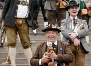 MUNICH, GERMANY - OCTOBER 05:  Bavarian riflemen of the Munich Salute Gun Regiment (Muenchner Boellerregiment) prepare to fire their traditional salute with one-shot guns on the steps under the Bavaria statue on the last day of the 2014 Oktoberfest on October 5, 2014 in Munich, Germany. The 181st Oktoberfest is coming to an end today an drew millions of visitors from across the globe in the world's largest beer fest.  (Photo by Johannes Simon/Getty Images)