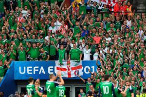 Northern Ireland supporters cheer during the Euro 2016 group C football match between Northern Ireland and Germany at the Parc des Princes stadium in Paris on June 21, 2016. Germany won the match 0-1. / AFP PHOTO / PATRIK STOLLARZPATRIK STOLLARZ/AFP/Getty Images
