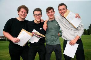 Students at Sullivan Upper School, Holywood, (from left) Danny Lyttle, Rory Caddy, Robin Watts and John Matchett, after receiving their A level results. Brian Lawless/PA Wire