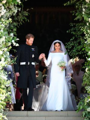 Meghan Markle and Prince Harry leave St George's Chapel at Windsor Castle following their wedding. PRESS ASSOCIATION Photo. Picture date: Saturday May 19, 2018. See PA story ROYAL Wedding. Photo credit should read: Jane Barlow/PA Wire