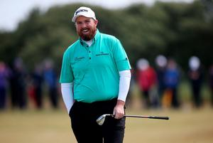 Ireland's Shane Lowry smiles after putting with his wedge during day two of the Dubai Duty Free Irish Open at Royal County Down Golf Club, Newcastle. PRESS ASSOCIATION Photo. Picture date: Friday May 29, 2015. See PA story GOLF Irish. Photo credit should read: Brian Lawless/PA Wire. RESTRICTIONS: Editorial use only. No commercial use. No false commercial association. No video emulation. No manipulation of images.