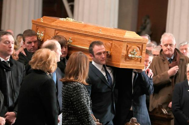 The coffin of the celebrated broadcaster Gay Byrne, is carried into St. Mary's Pro-Cathedral in Dublin for his funeral service. PA Photo. Pic