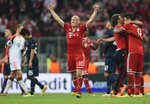 MUNICH, GERMANY - APRIL 09:  Arjen Robben of Bayern Muenchen celebrates victory after the UEFA Champions League Quarter Final second leg match between FC Bayern Muenchen and Manchester United at Allianz Arena on April 9, 2014 in Munich, Germany.  (Photo by Lars Baron/Bongarts/Getty Images)