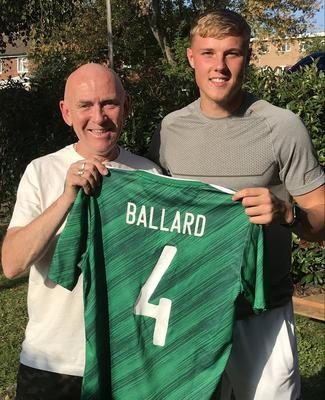 Daniel Ballard (right) presented his old mentor Brian Stapleton with his shirt from his senior Northern Ireland debut, against Romania last month.