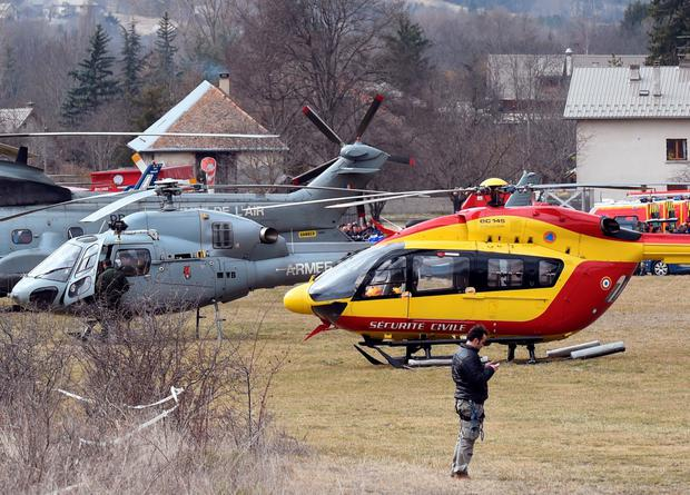 Helicopters of the French Air Force (back) and civil security services are seen in Seyne, south-eastern France, on March 24, 2015, near the site where a Germanwings Airbus A320 crashed in the French Alps.