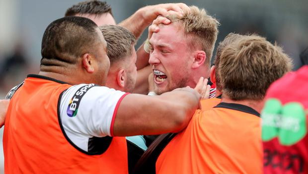Ulster's Kieran Treadwell celebrates his try with team-mates.