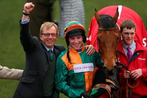 CHELTENHAM, ENGLAND - MARCH 12:  Gavin Sheehan on Cole Harden celebrates after winning the Ladbrokes World Hurdle during St Patrick's Thursday at the Cheltenham Festival at Cheltenham Racecourse on March 12, 2015 in Cheltenham, England.  (Photo by Alex Livesey/Getty Images)
