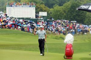 LOUISVILLE, KY - AUGUST 08:  Rory McIlroy of Northern Ireland celebrates an eagle putt on the 18th green during the second round of the 96th PGA Championship at Valhalla Golf Club on August 8, 2014 in Louisville, Kentucky.  (Photo by Andrew Redington/Getty Images)