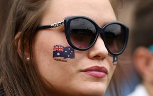 LONDON, ENGLAND - JUNE 24:  A spectator with the Australian national flag painted on her face watches the action during day one of the Wimbledon Lawn Tennis Championships at the All England Lawn Tennis and Croquet Club on June 24, 2013 in London, England.  (Photo by Dan Kitwood/Getty Images)