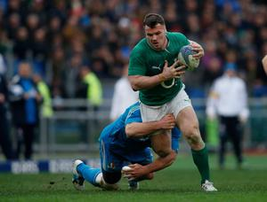 ROME, ITALY - MARCH 16:  Cian Healy of Ireland is tackled during the RBS Six Nations match between Italy and Ireland at Stadio Olimpico on March 16, 2013 in Rome, Italy.  (Photo by Tom Shaw/Getty Images)