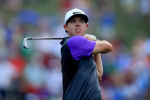 LOUISVILLE, KY - AUGUST 10:  Rory McIlroy of Northern Ireland hits an approach shot on the first hole during the final round of the 96th PGA Championship at Valhalla Golf Club on August 10, 2014 in Louisville, Kentucky.  (Photo by David Cannon/Getty Images)
