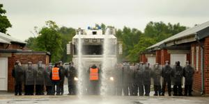 Police officers including members of the PSNI undergo riot training including the use of a water cannon at Longmoor Army Camp ahead of the G8 meeting in Northern Ireland. PRESS ASSOCIATION Photo. Picture date: Wednesday May 29, 2013. See PA story POLICE G8. Photo credit should read: Andrew Matthews/PA Wire