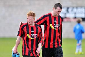 A dejected John Neill and Lee Forgrave after Tobermore were relegated last May. However, with games in hand and in a run of good form, the club hope they won't have another relegation battle on their hands this season