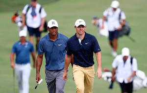 Rory McIlroy and Tiger Woods approach the 18th green at Muirfield Village during the second round of the Memorial Tournament (Jamie Squire/Getty Images)
