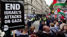 Police stand between pro-Israeli (centre by gates) and pro-Palestinian demonstrators (R and foreground) outside the gates of Downing Street in London on September 9, 2015. Over 100 pro-Israeli demonstrators and hundreds of pro-Palestinian activists rallied in front of Downing Street in London ahead of a planned visit of Israeli Prime Minister Benjamin Netanyahu. Netanyahu visits Britain this week for talks with his counterpart David Cameron as the right-wing Israeli leader faces diplomatic pressure over West Bank settlements and stalled peace efforts. AFP PHOTO / JUSTIN TALLISJUSTIN TALLIS/AFP/Getty Images